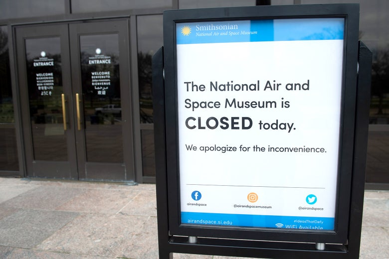 A sign outside the Smithsonian National Air and Space Museum states that the museum is closed because of a partial government shutdown in Washington.