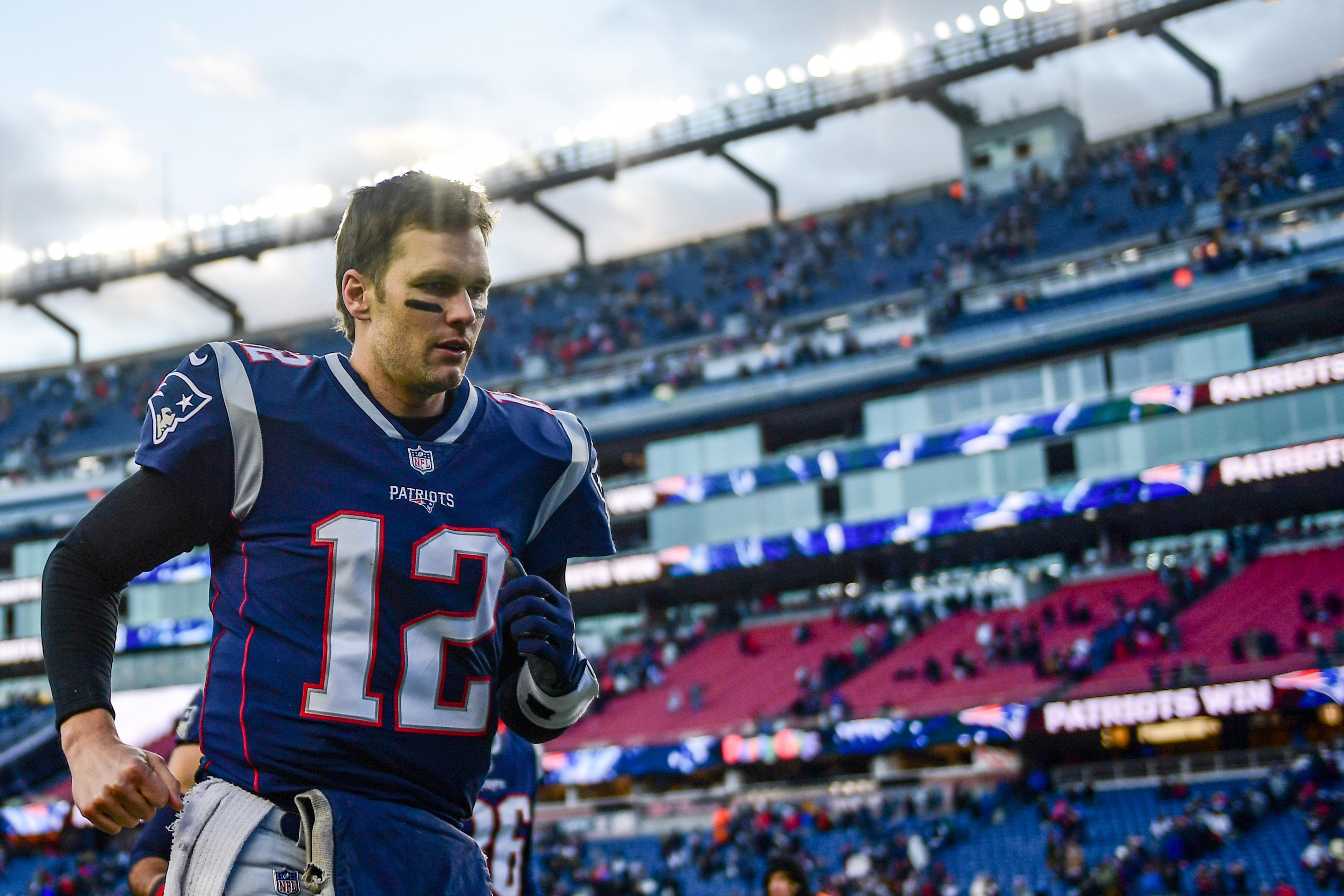 FOXBOROUGH, MASSACHUSETTS - DECEMBER 30: Tom Brady #12 of the New England Patriots runs off the field after a game against the New York Jets at Gillette Stadium on December 30, 2018 in Foxborough, Massachusetts. (Photo by Billie Weiss/Getty Images)