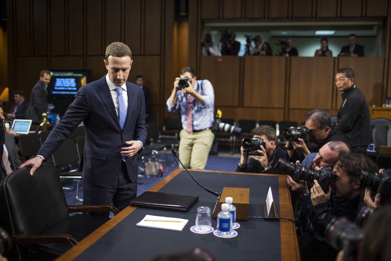 WASHINGTON, DC - APRIL 10: Facebook co-founder, Chairman and CEO Mark Zuckerberg arrives for testimony before a combined Senate Judiciary and Commerce committee hearing in the Hart Senate Office Building on Capitol Hill April 10, 2018 in Washington, DC. Zuckerberg, 33, was called to testify after it was reported that 87 million Facebook users had their personal information harvested by Cambridge Analytica, a British political consulting firm linked to the Trump campaign. Photo by Zach Gibson/Getty Images)