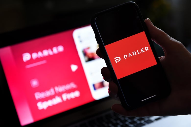 This illustration picture shows social media application logo from Parler displayed on a smartphone with its website in the background in Arlington, Virginia on July 2, 2020.