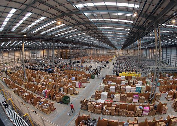 Employees select and dispatch items in the huge Amazon 'fulfillment center' warehouse on November 28, 2013 in Peterborough, England.