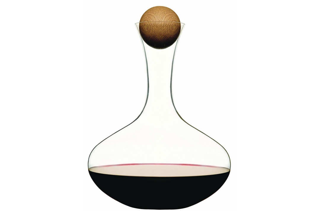 Glass carafe with spherical wooden stopper.