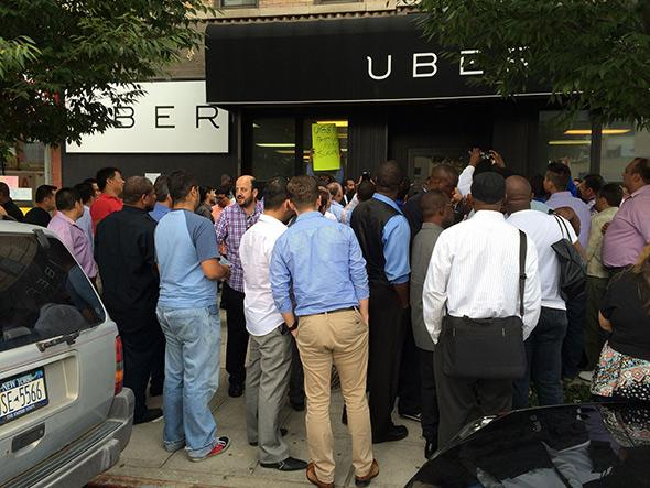Drivers gather outside Uber's New York City office to protest in September.