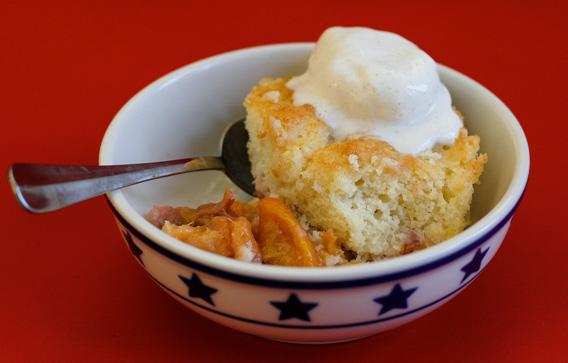 Peach cobbler with vanilla ice cream.