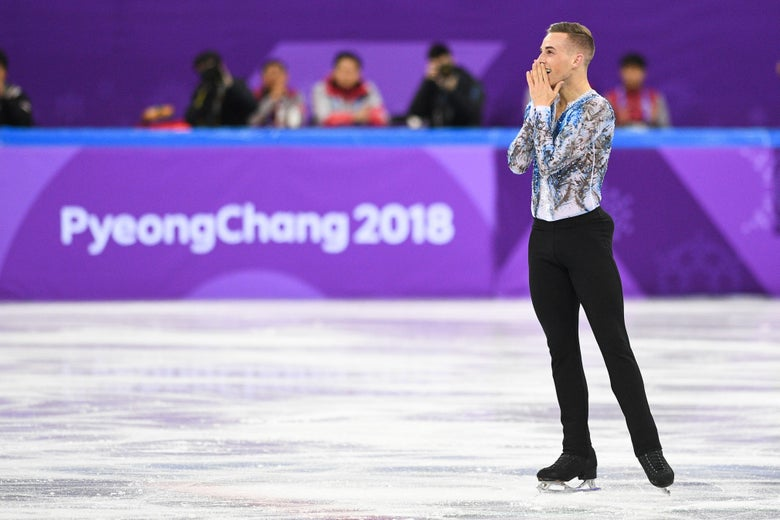 Adam Rippon holds his hands to his face in celebration on ice.