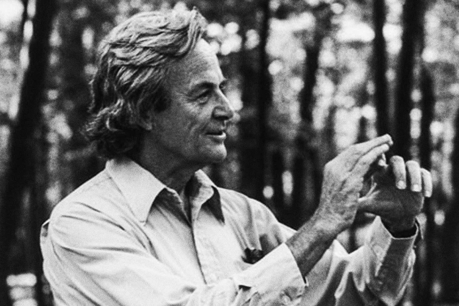 A black-and-white photo of Richard Feynman.