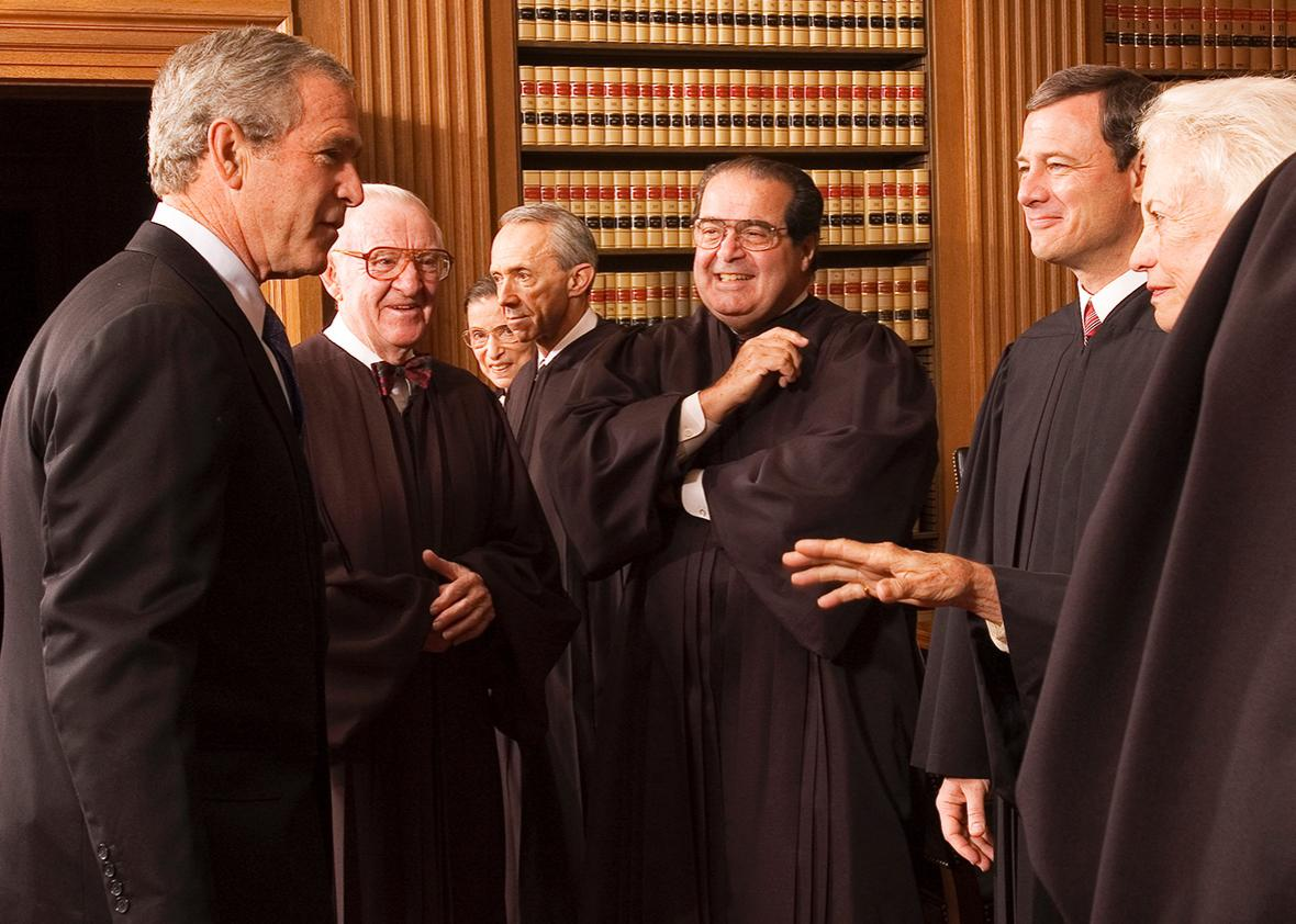 President George W. Bush enjoys a light moment with members of the Supreme Court, Oct. 3, 2005.