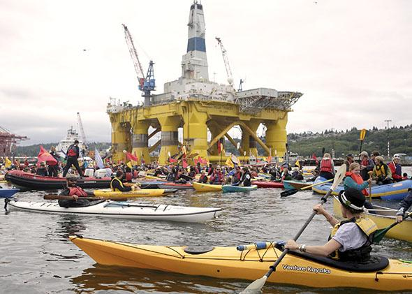 Kayactivists protest the Shell Oil Company's drilling rig Polar Pioneer which is parked at Terminal 5 at the Port of Seattle