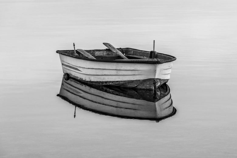 A row boat, in black and white.