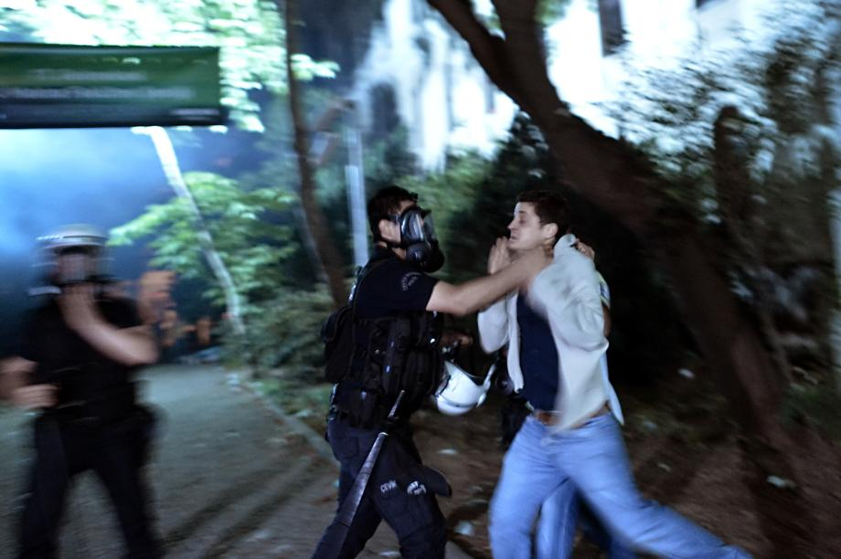 A riot policeman detains a demonstrator in Istanbul on June 4, 2013.