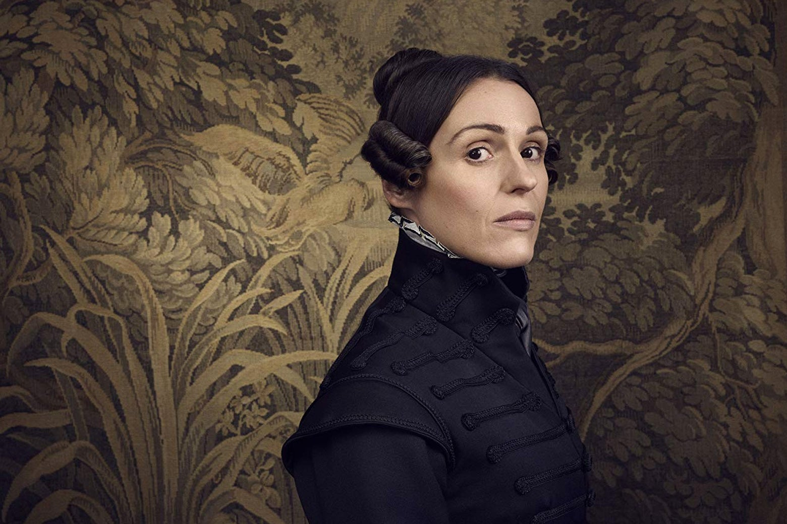 Suranne Jones in a dark suit in Gentleman Jack.