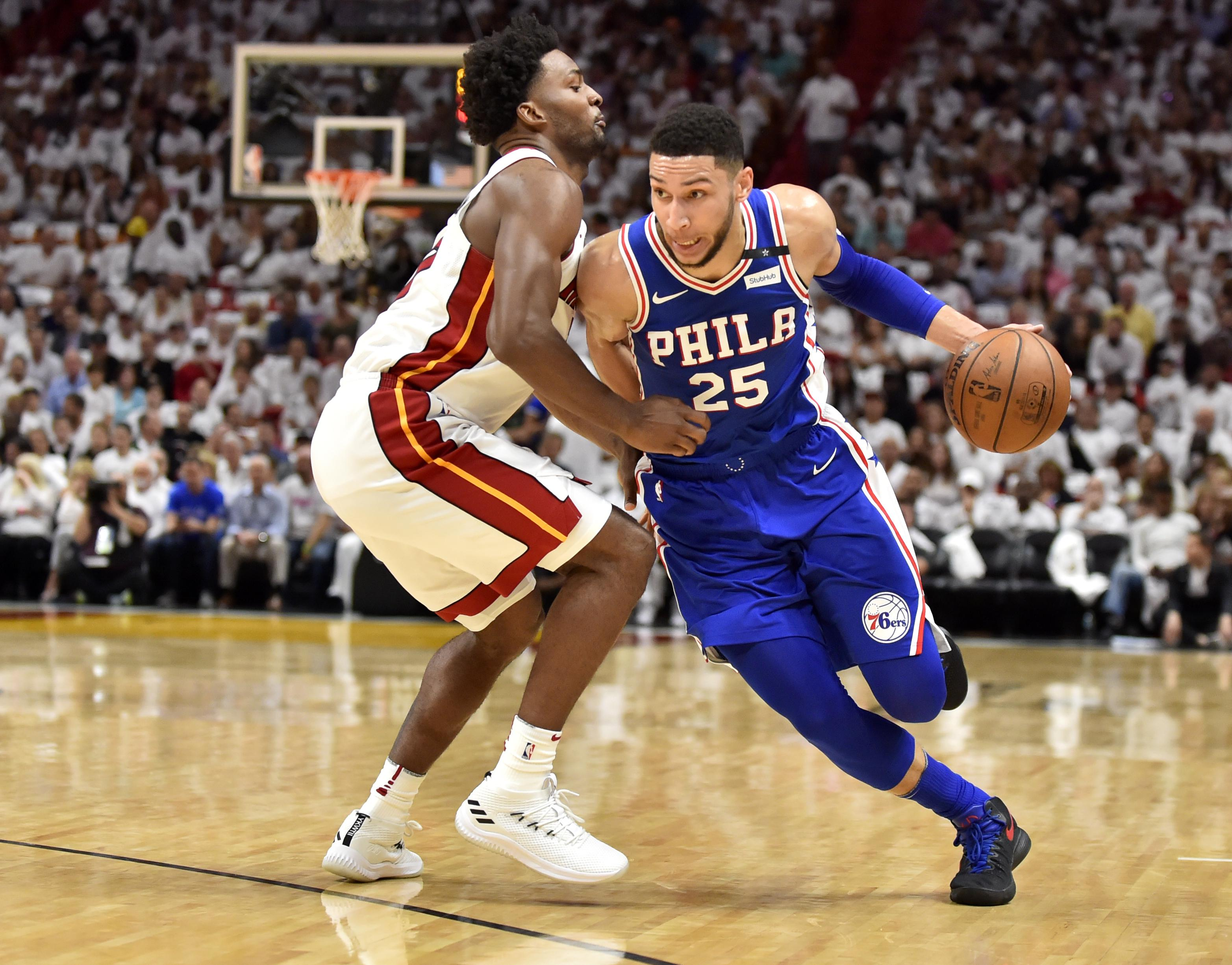 MIAMI, FL - APRIL 19: Ben Simmons #25 of the Philadelphia 76ers drives to the basket while being defended by Justise Winslow #20 of the Miami Heat during the first quarter of the game at American Airlines Arena on April 19, 2018 in Miami, Florida. NOTE TO USER: User expressly acknowledges and agrees that, by downloading and or using this photograph, User is consenting to the terms and conditions of the Getty Images License Agreement. (Photo by Eric Espada/Getty Images)