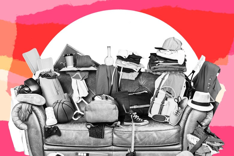 A couch with a variety of junk piled on top of it.