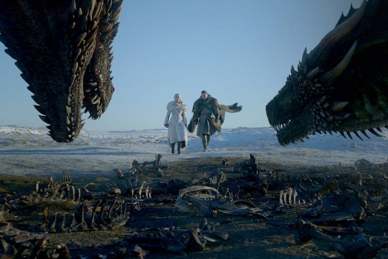 Daenerys Targaryen and Jon Snow, flanked by dragons and animal bones.