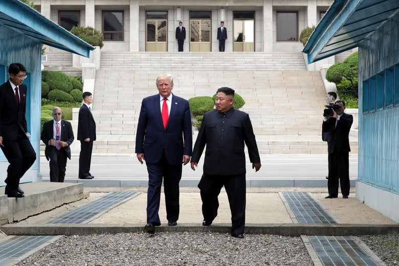 North Korean leader Kim Jong-un and U.S. President Donald Trump walk inside the demilitarized zone separating South and North Korea.