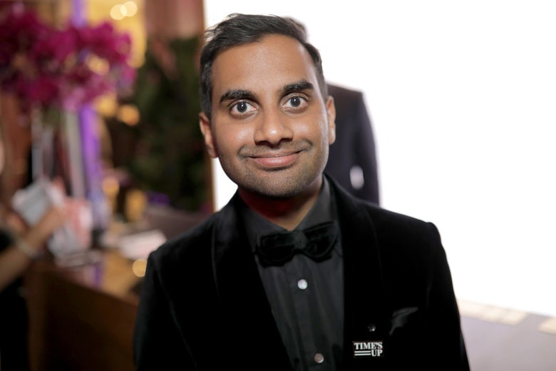 Aziz Ansari wears a Time's Up pin.