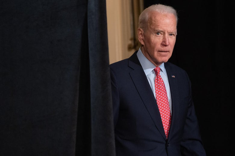Biden steps out from behind a curtain