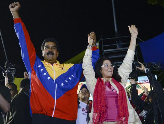Venezuelan President elect Nicolas Maduro (L) celebrates with his wife Cilia Flores after knowing the election results in Caracas on April 14, 2013.