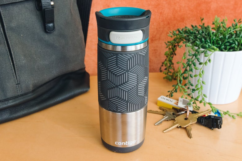 The Contigo mug beside keys and a plant