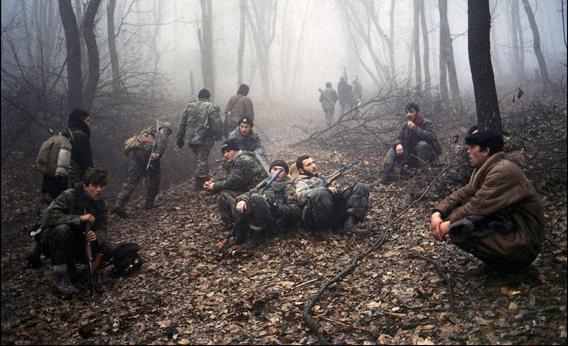 Members of the Chechen army continue to enter Grozny, attempting to retake the city, circa 1999. Here, the soldiers are seen taking a break after a long night on the road.