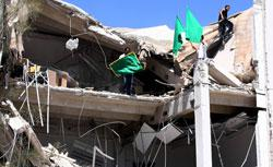 Libyans carry flags in the rubble of a university building in Tripoli. Click to expand image.