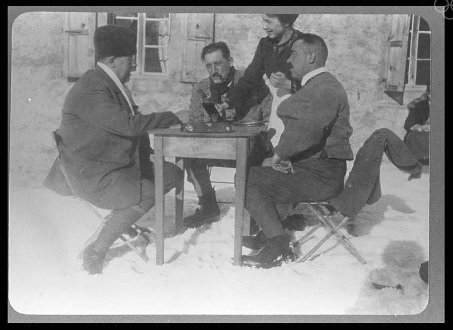 Three members of the Swedish curling team taking a break to have a drink.