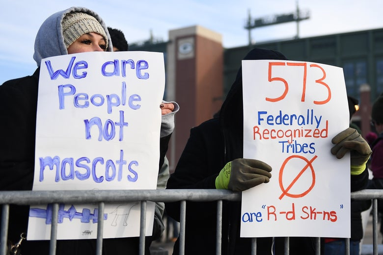 Protesters rally outside of Lambeau Field prior to the game between the Green Bay Packers and the Washington NFL team on December 8, 2019 in Green Bay, Wisconsin.