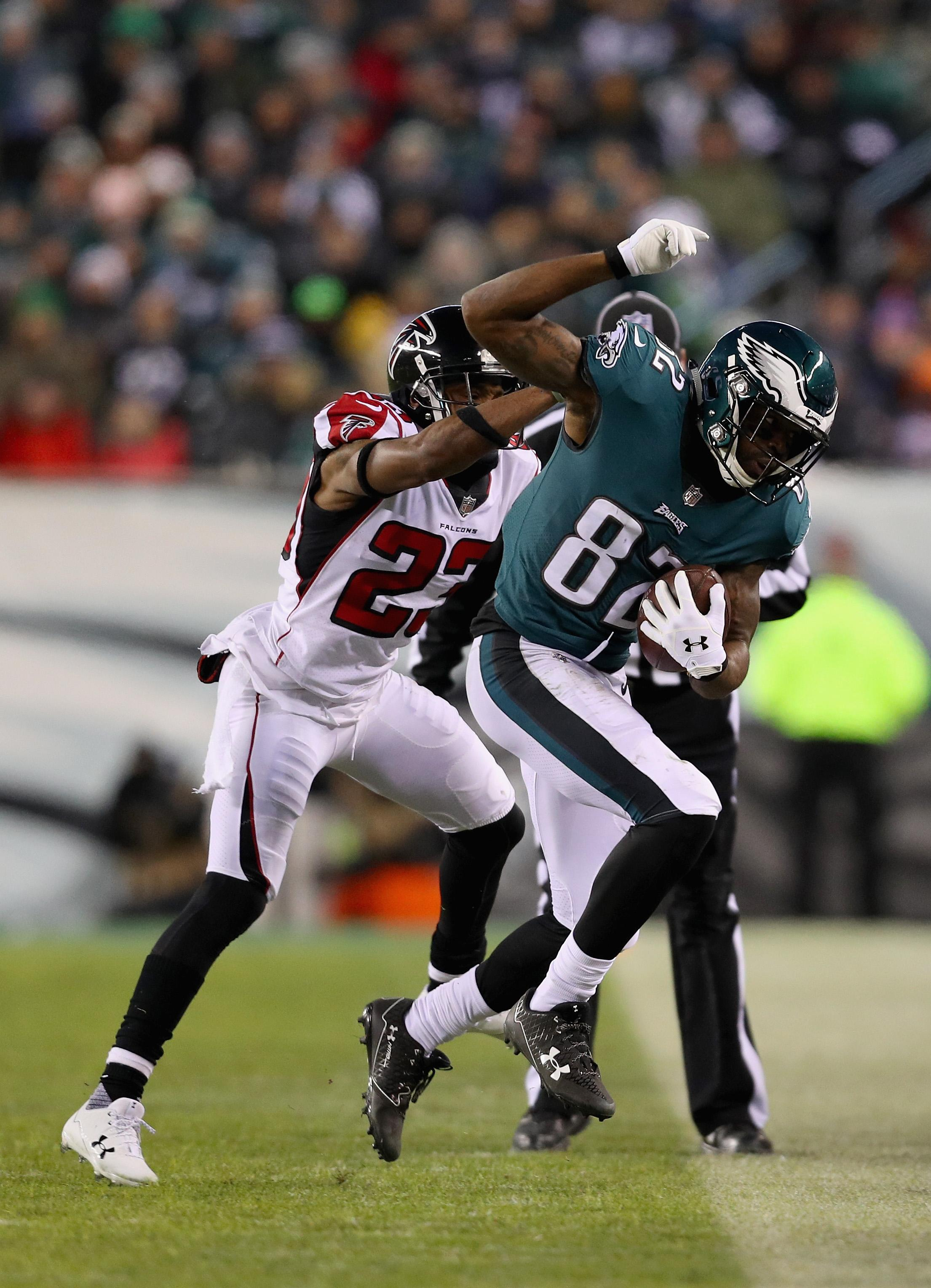 PHILADELPHIA, PA - JANUARY 13: Wide receiver Torrey Smith #82 of the Philadelphia Eagles runs the ball against cornerback Robert Alford #23 of the Atlanta Falcons during the second quarter in the NFC Divisional Playoff game at Lincoln Financial Field on January 13, 2018 in Philadelphia, Pennsylvania.  (Photo by Patrick Smith/Getty Images)