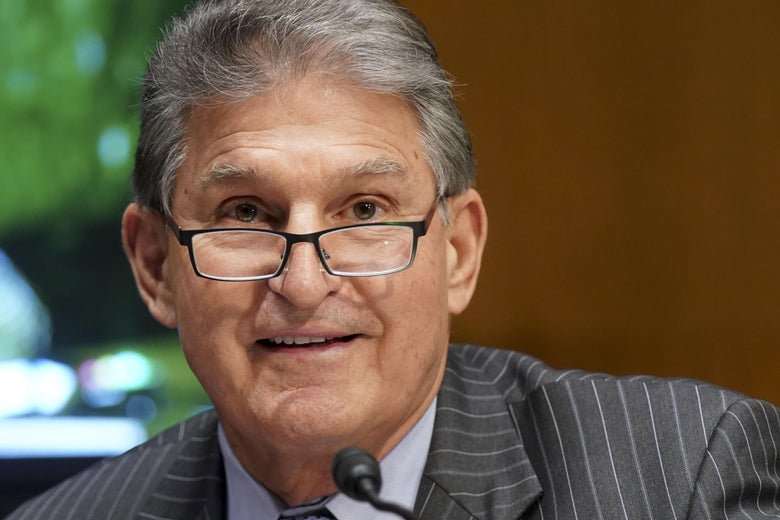 A close up of Manchin during a Senate subcommittee hearing.