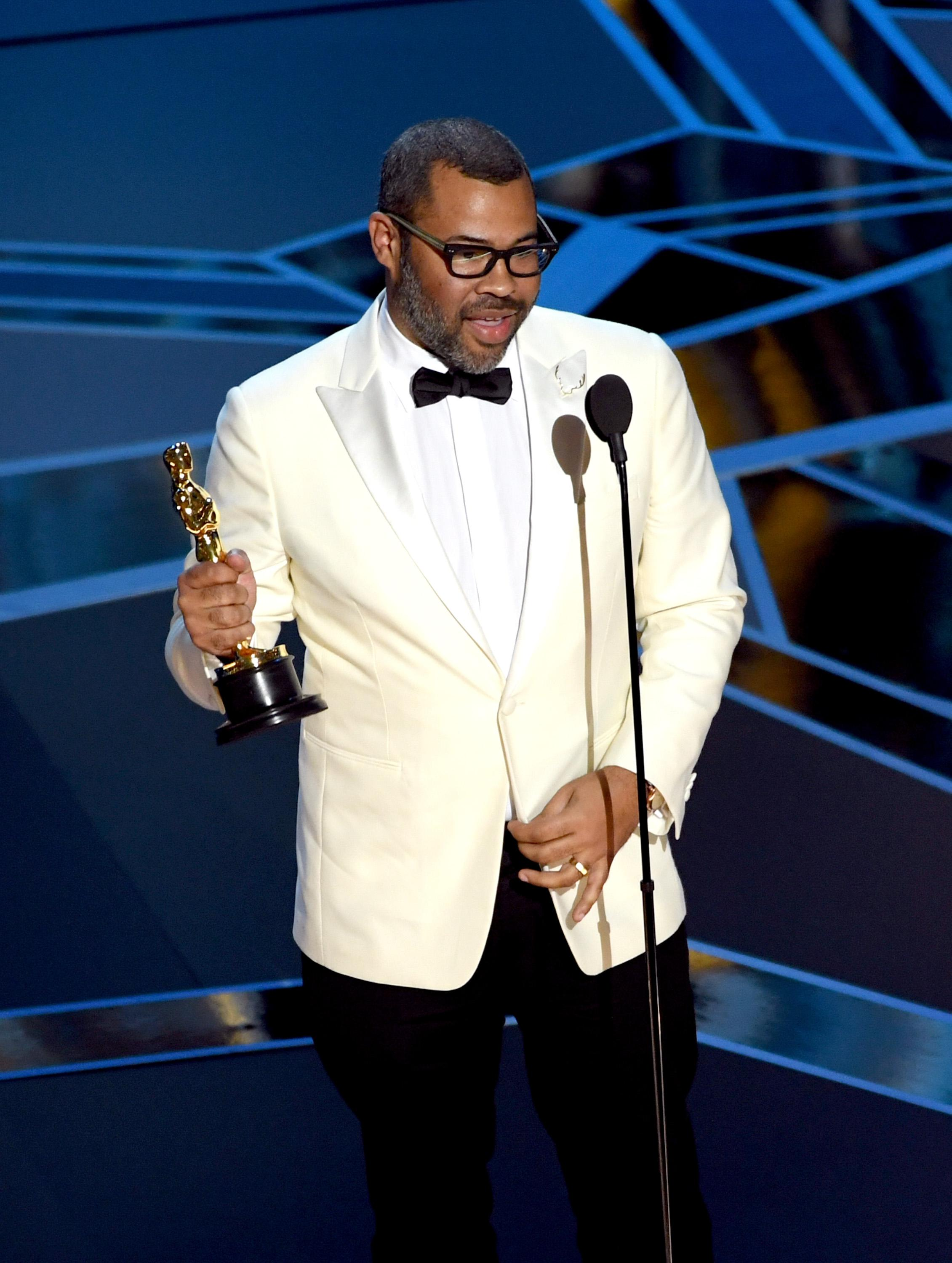Writer/director Jordan Peele accepts Best Original Screenplay for 'Get Out' onstage during the 90th Annual Academy Awards at the Dolby Theatre at Hollywood & Highland Center on March 4, 2018 in Hollywood, California.  (Photo by Kevin Winter/Getty Images)