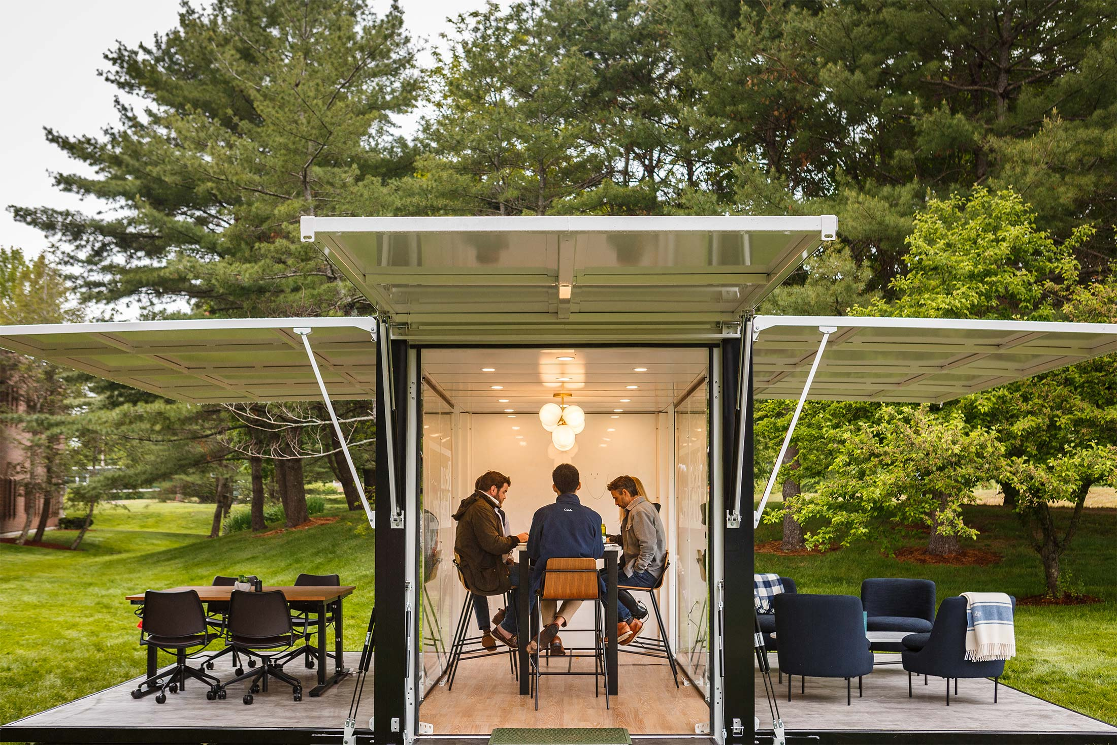 An indoor-outdoor working space amid some trees.