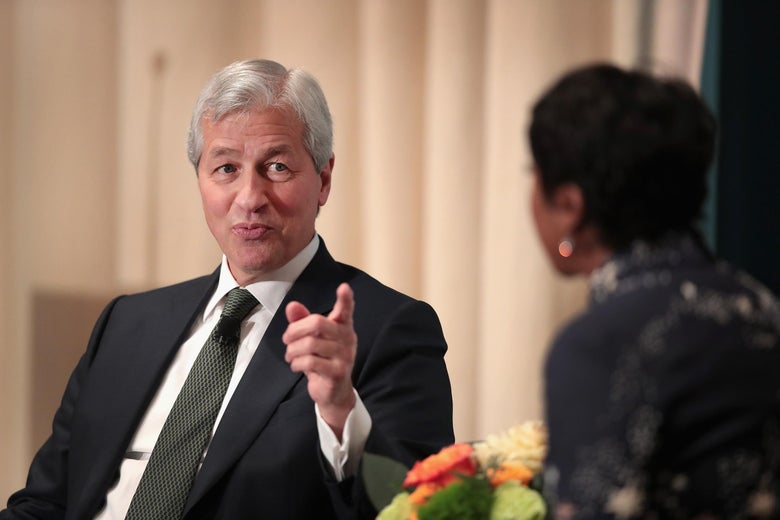 Jamie Dimon being interviewed on a stage