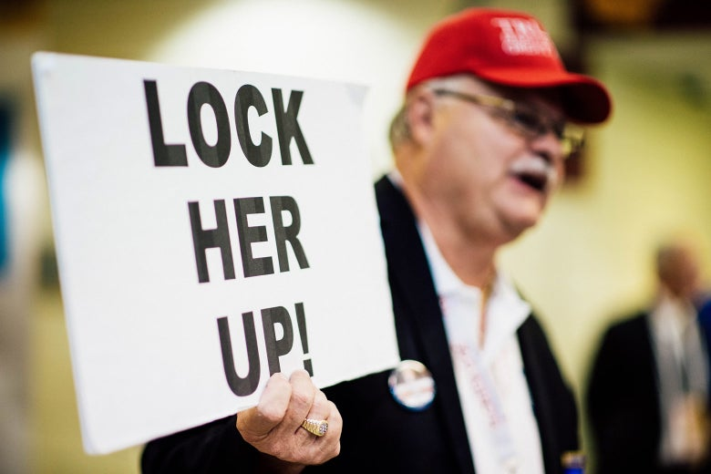 Florida delegate Henry Allen carries a Lock Her Up sign through the Quicken Loans Arena at the 2016 Republican National Convention in Cleveland on July 20, 2016.