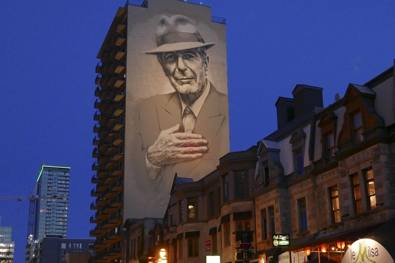 The mural of the late Canadian singer-songwriter Leonard Cohen, inaugurated in November 2017 over a Montreal street, now lit up every night, is viewed on June 23, 2019 on Crescent Street in Montreal.