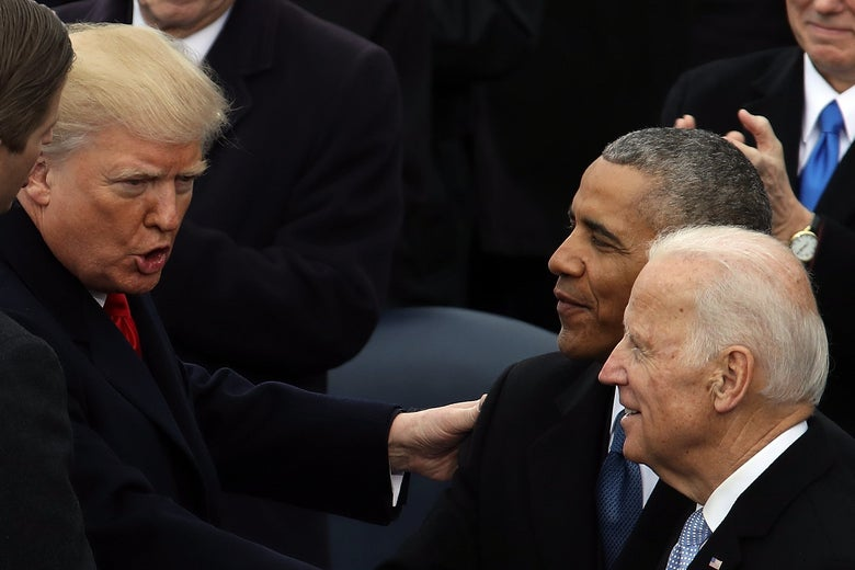 Trump gestures as Biden and Obama look on.