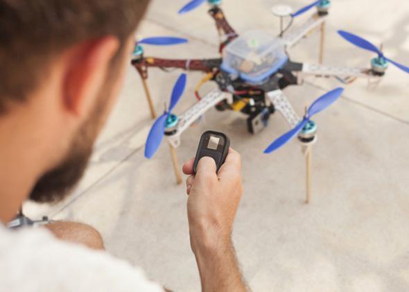 Man operating drone.