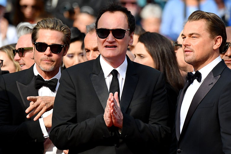 Brad Pitt, Quentin Tarantino, and Leonardo DiCaprio arrive for the screening of the film Once Upon a Time in Hollywood at the Cannes Film Festival on Tuesday.