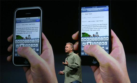 Apple Senior Vice President of Worldwide product marketing Phil Schiller announces the new iPhone 5 during an Apple special event.