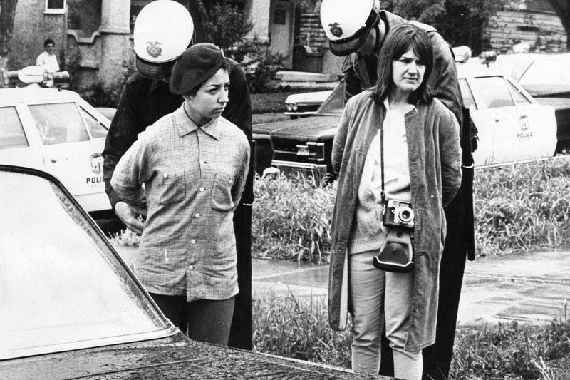 Police handcuff two young women in front of Belmont High School during a protest at the school on March 8, 1968, in Los Angeles.
