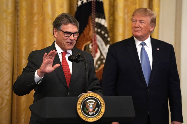 Energy Secretary Rick Perry speaks as President Donald Trump looks on at the White House on July 7, 2019.