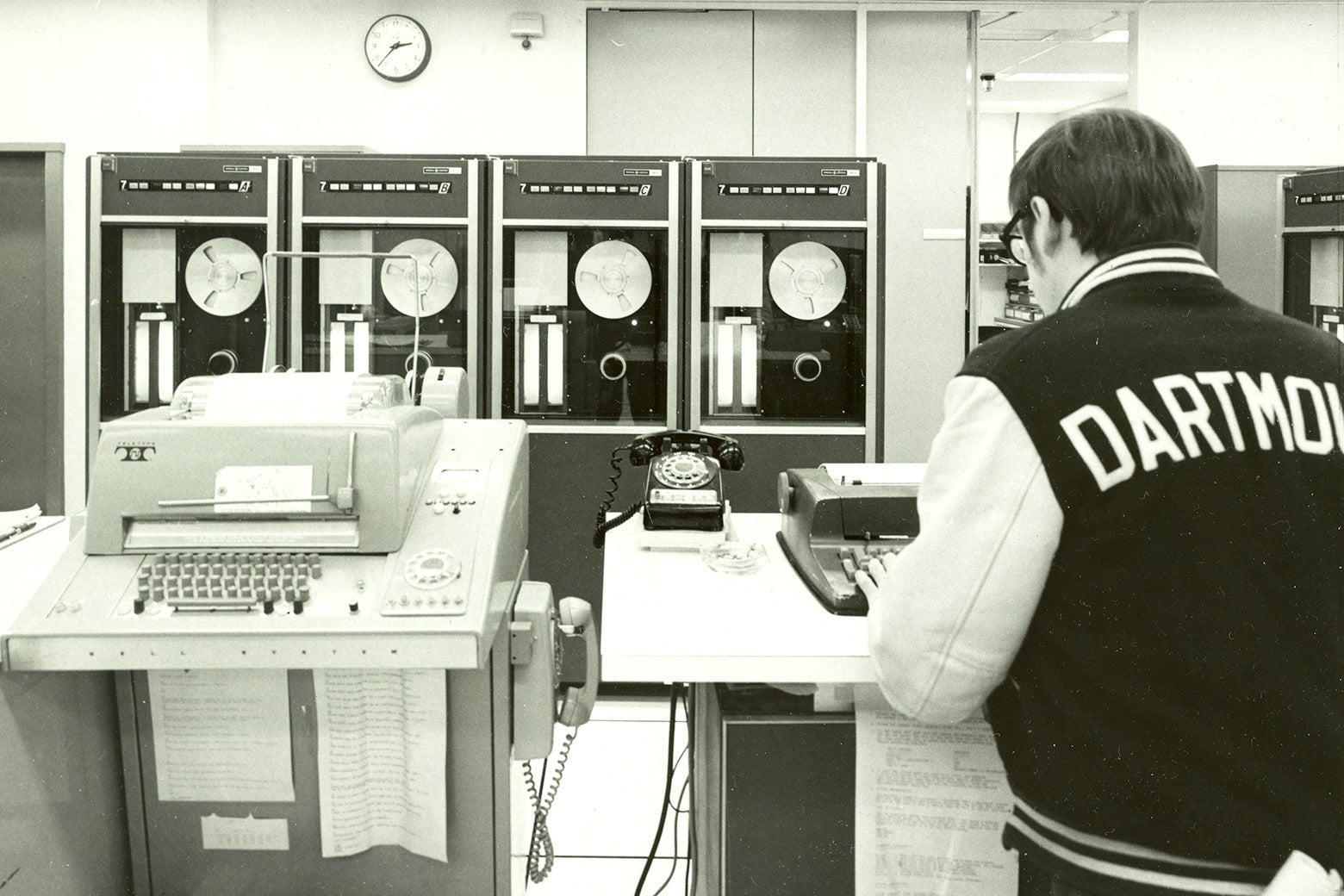 A Dartmouth College student works on an upgraded GE 635 time-sharing system.