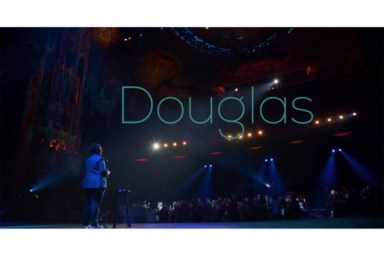 The title screen from Douglas, showing Hannah Gadsby facing the audience at the theater at the Ace Hotel.