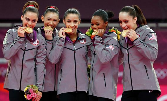 United States celebrate after winning the gold medal in the Artistic Gymnastics Women's Team.