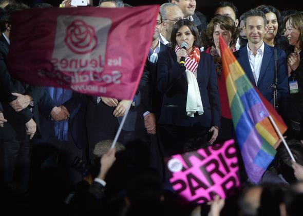 Anne Hidalgo and a rainbow flag