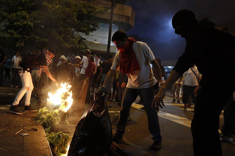 Demonstrators make a barricade of burning garbage during a protest against Venezuela's President Nicolas Maduro's government in Caracas.