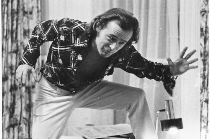 Don McGregor in the 1970s, doing Panther poses for his colleague to sketch.