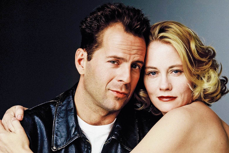 Cybill Shepherd wraps her arms around Bruce Willis.