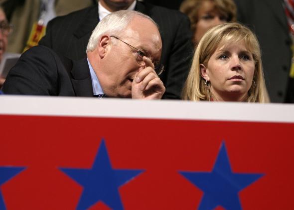 Dick Cheney whispers in Liz Cheney's ear.