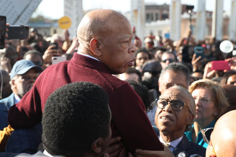 Rep. John Lewis is held aloft by Rev. Al Sharpton and others as he speaks to the crowd at the Edmund Pettus Bridge crossing reenactment marking the 55th anniversary of Selma's Bloody Sunday on March 1, 2020 in Selma, Alabama.