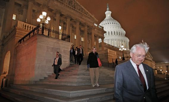 """Members of the House of Representatives leave after voting for legislation to avoid the """"fiscal cliff"""" during a rare New Year's Day session Jan. 1, 2013, in Washington, D.C."""